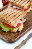 Tasty healthy sandwiches at white wooden table. Stock Photos