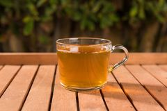 Tasty herbal tea in glass cup on the table. Summer leisure royalty free stock photo