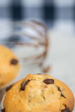 Tasty home made muffins with whisk covered in melting chocolate Royalty Free Stock Photography
