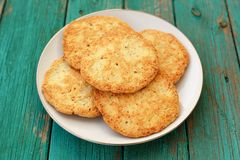 Tasty homemade almond cookies in white plate on turquoise vintag Royalty Free Stock Photos