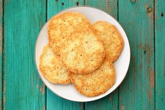 Tasty homemade almond cookies in white plate on turquoise vintag Stock Photo