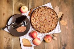 Tasty homemade apple pie Apple pie Apples Cinnamon Plate Napkin Wooden background Top view Stock Photography