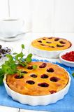 Tasty homemade berry pies in a round ceramic form Stock Photos