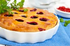 Tasty homemade berry pies in a round ceramic form Stock Image