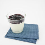 The tasty homemade blueberry panna cotta (Italian pudding dessert) in the small glass Royalty Free Stock Image