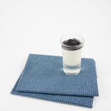The tasty homemade blueberry panna cotta (Italian pudding dessert) in the small glass Stock Images