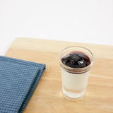 The tasty homemade blueberry panna cotta (Italian pudding dessert) in the small glass Royalty Free Stock Photography