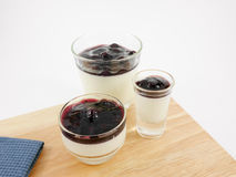 The tasty homemade blueberry panna cotta (Italian pudding dessert) in the small glass Stock Photos