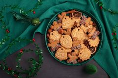 Tasty homemade Christmas cookies in the green plate. royalty free stock photos