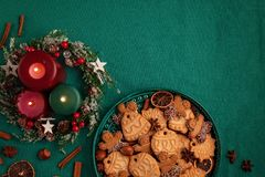 Tasty homemade Christmas cookies in the green plate. royalty free stock photography
