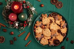 Tasty homemade Christmas cookies in the green plate. royalty free stock images