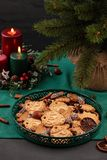 Tasty homemade Christmas cookies in the green plate. stock image