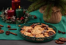 Tasty homemade Christmas cookies in the green plate. royalty free stock image