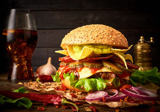 Tasty hоmemade delicious burger with guacamole and nachos on a royalty free stock images