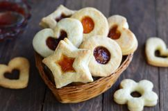 Tasty jam cookies of different shapes stock images