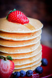 Tasty homemade pancakes with strawberries,blueberries and maple Stock Image