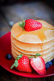 Tasty homemade pancakes with strawberries,blueberries and maple Royalty Free Stock Photos