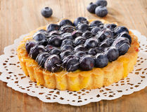 Tasty homemade pie with blueberries  on a wooden table Royalty Free Stock Photography