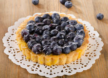 Tasty homemade pie with blueberries  on wooden table Stock Photo