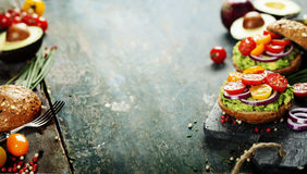 Tasty homemade sandwiches with avocado, tomato, onion and pepper Stock Photography