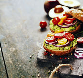 Tasty homemade sandwiches with avocado, tomato, onion and pepper Royalty Free Stock Photos
