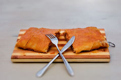 Tasty homemade strudel on wooden table Stock Photography