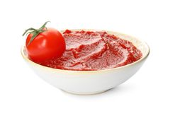 Tasty homemade tomato sauce. And fresh vegetable in bowl on white background stock photo