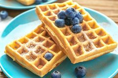 Tasty homemade waffles with sugar powder and blueberries Royalty Free Stock Photography