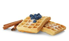 Tasty homemade waffles with sugar powder, cinnamon sticks and blueberries Royalty Free Stock Image