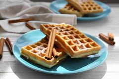 Tasty homemade waffles with sugar powder and cinnamon sticks Stock Image