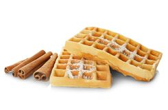 Tasty homemade waffles with sugar powder and cinnamon sticks Royalty Free Stock Images