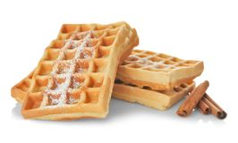 Tasty homemade waffles with sugar powder and cinnamon sticks Stock Images