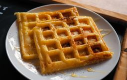 Tasty homemade waffles with sweet sauce Royalty Free Stock Photo