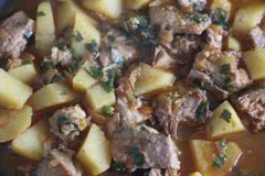 Tasty dish with meat and potatoes stock images
