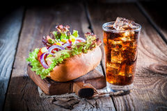 Tasty hot dog with vegetables and sausage Stock Photo