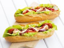 Tasty hot dogs on a wooden table Royalty Free Stock Image