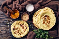 Tasty hot freshly baked indian flatbread - naan stock image