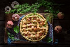 Tasty and hot peaches pie made of fresh ingredients Stock Photo