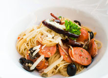 Tasty hot and spicy spaghetti with thai sausage Royalty Free Stock Images