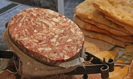 Tasty and huge salami and bread sold at Italian market Royalty Free Stock Images