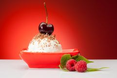 Tasty ice cream ball with berries Stock Photo