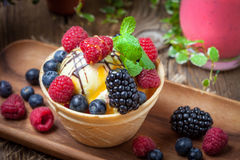 Tasty ice cream dessert with fruit in a waffle bowl. Selective focus Royalty Free Stock Photos