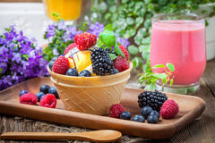 Tasty ice cream dessert with fruit in a waffle bowl. Selective focus Royalty Free Stock Photo