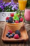 Tasty ice cream dessert with fruit in a waffle bowl. Selective focus Stock Photo