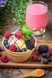 Tasty ice cream dessert with fruit in a waffle bowl. Selective focus Royalty Free Stock Image