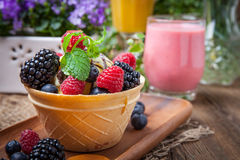 Tasty ice cream dessert with fruit in a waffle bowl. Selective focus Royalty Free Stock Images