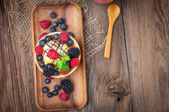 Tasty ice cream dessert with fruit in a waffle bowl. Selective focus. Top view Royalty Free Stock Photos