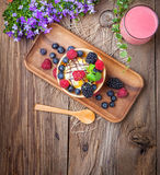 Tasty ice cream dessert with fruit in a waffle bowl. Selective focus. Top view Royalty Free Stock Images