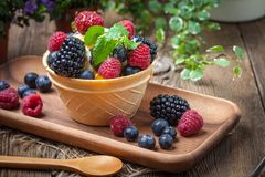 Tasty ice cream dessert with fruit in a waffle bowl. Selective focus Stock Photography