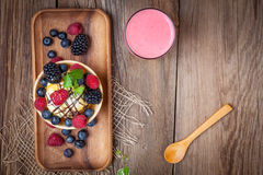 Tasty ice cream dessert with fruit in a waffle bowl. Top view Stock Image